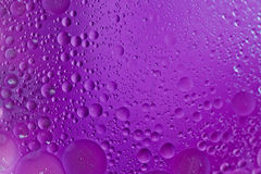 Olive Oil Abstract/ Background. Macro shot of Olive oil mixed in water abstract with purple background Royalty Free Stock Photography