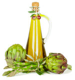 Olive oil, artichokes and  asparagus. Royalty Free Stock Photography