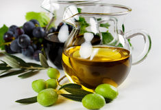 Olive oil and balsamic vinegar. Extra virgin olive oil and balsamic vinegar on white background royalty free stock images