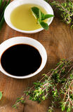 Olive oil, balsamic vinegar and herbs Stock Image