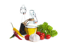 Olive oil and balsamic vinegar with vegetables Stock Photos