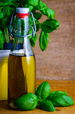 Olive oil and basil Stock Photo