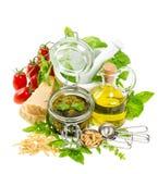 Olive oil, basil, parmesan, pine nuts, tomato Stock Photos