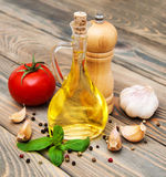 Olive oil,  basil, tomato and garlic Stock Photos