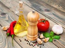 Olive oil,  basil, tomato and garlic Stock Photos