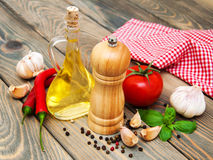 Olive oil,  basil, tomato and garlic Royalty Free Stock Photography