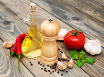 Olive oil,  basil, tomato and garlic Stock Photography