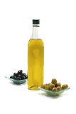 Olive oil and black olives Stock Photos
