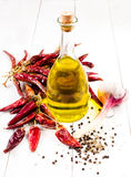 Olive oil bottle and bunch with Dried Red hot chili pepper on wh Stock Image