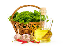 Olive oil in a bottle with fresh vegetables Stock Photo