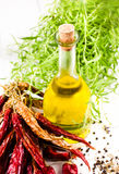 Olive oil bottle, herbs and Red hot chili pepper on white backgr Stock Photo