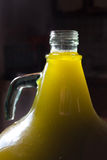Olive oil bottle in the light Royalty Free Stock Images