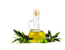 Olive oil bottle and olive branch isolated on white. Royalty Free Stock Photo