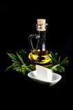 Olive oil bottle, olive branch, and white cheese Royalty Free Stock Image