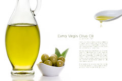 Olive Oil on Bottle with Olive Seeds and Ceramic Spoon Royalty Free Stock Images