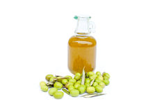 Olive oil bottle with olives. Near it on white background Stock Photos