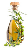 Olive oil in bottle and olives Stock Images