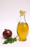 Olive oil bottle with onion and parsley Stock Photo