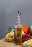 Olive Oil Bottle with organic pumpkin squash with fresh vegetabl Stock Image