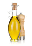 Olive oil bottle and pepper shaker Royalty Free Stock Images