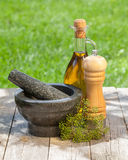 Olive oil bottle, pepper shaker and mortar Royalty Free Stock Photos