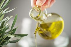Olive oil bottle pouring close up stock photos
