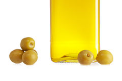 Olive oil bottle and some olives Stock Photography