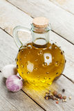 Olive oil bottle with spices Royalty Free Stock Photo