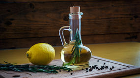 Olive oil bottle still-life over dark background Royalty Free Stock Photo