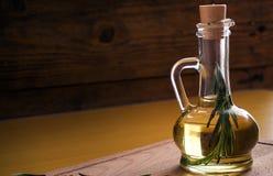 Olive oil bottle still-life over dark background Royalty Free Stock Images