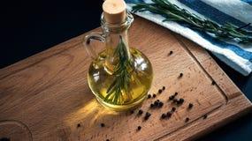 Olive oil bottle still-life over dark background Stock Image