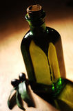 Olive Oil Bottle on the Table Royalty Free Stock Photography