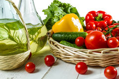 Olive oil in a bottle and vegetables stock photography