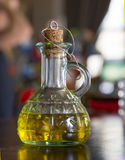 Olive oil. Bottle with a virgin olive oil Royalty Free Stock Photos