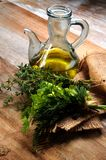 Olive oil bottled and fine fresh herbs Royalty Free Stock Photography