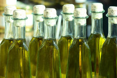 Olive oil in bottles Stock Photos