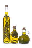 Olive oil bottles with aromatic herbs Stock Image