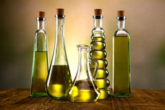 Olive oil in bottles background Royalty Free Stock Image