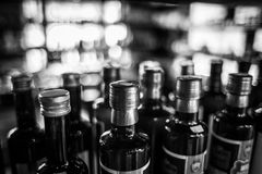 Olive oil bottles with blurry background stock photos