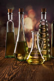 Olive oil in bottles closeup Stock Images