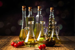 Olive oil in bottles Stock Photos