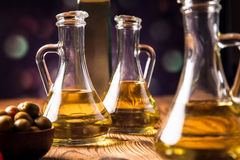 Olive oil in bottles Stock Images