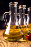 Olive oil in bottles Stock Images