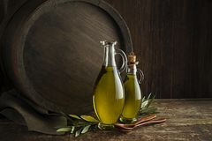 Olive oil with barrel background. Bottles of Extra virgin healthy Olive oil with barrel background royalty free stock photo