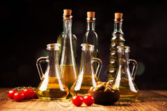 Olive oil in bottles Stock Photo