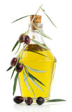 Olive oil and branch of an olive tree Stock Photo