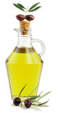 Olive oil and branch of an olive tree Stock Images