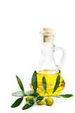 Olive oil and branch with olives on white Royalty Free Stock Images