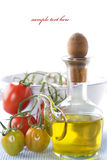 Olive oil and branch of organic tomatoes Royalty Free Stock Image