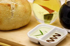 Olive oil and bread. White rustic bread with olive oil and balsamic vinegar Royalty Free Stock Image